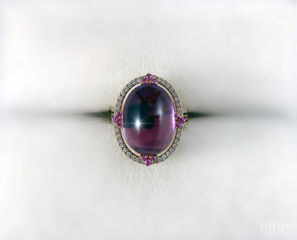 18k yellow and white gold cabochon amethyst, diamond and pink sapphire ring, made in Milan.