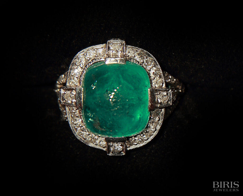 Cabochon emerald and diamond ring , platinum