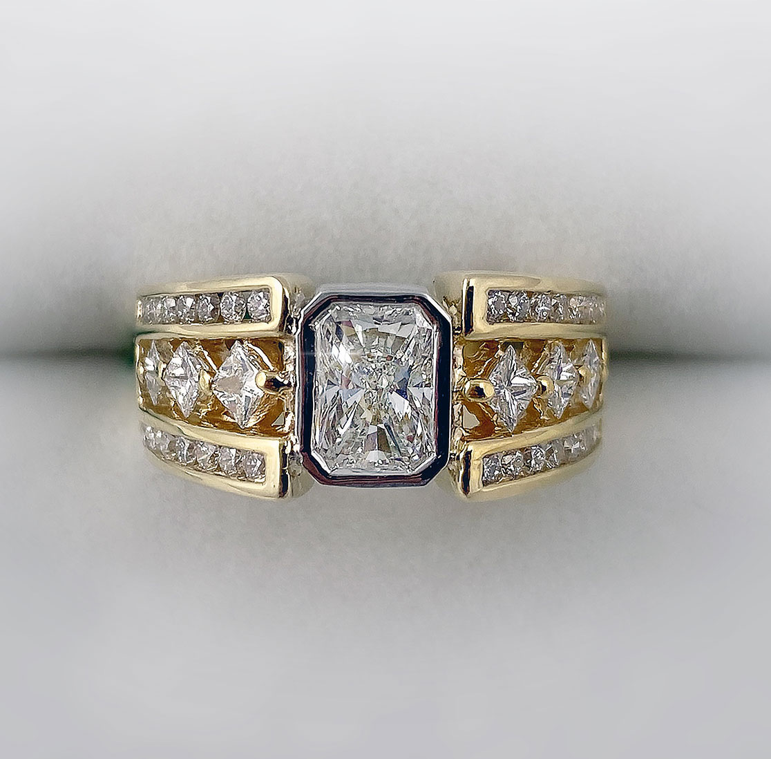 14k yellow gold and platinum bezel set radiant cut diamond, 1.00ct. Gia certificate
